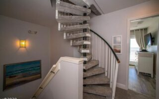 Spiral stairs lead up to the loft room